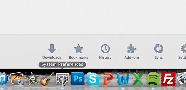 click on System Preferences in the Dock