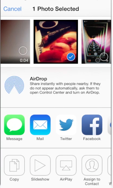"""the picture sharing menu of """"Photos"""" app on iPhone running iOS 7"""