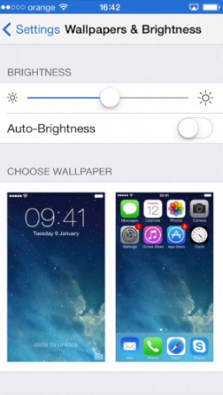 "toggling ""Auto-Brightness"" to ""OFF"" on iPhone running on iOS 7"